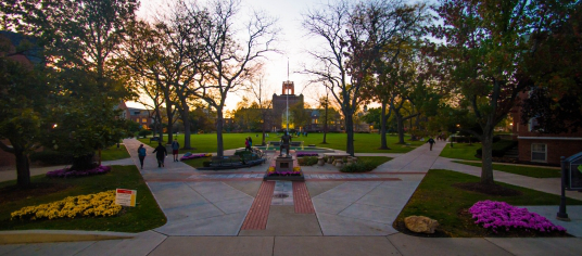 Image taken at dusk of the St. Ignatius statue and quad from the front steps of the Student Center